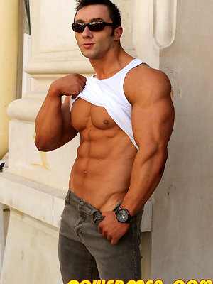 Brunette bodybuilder Chris Bortone shows his perfect muscle body