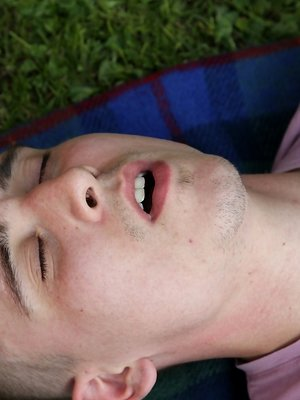 Joshua Czech lays a blanket down outside and busts a nut.