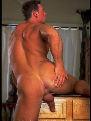 Hung muscle man Istvan Turani shows his big uncut cock