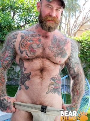 Jack Dixon shows his hairy muscled body and pierced dick